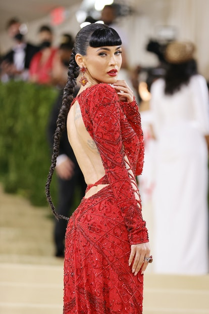 At the 2021 Met Gala, Megan Fox wore a long high ponytail braid with chords intertwined.