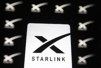 UKRAINE - 2021/02/21: In this photo illustration a Starlink logo of a satellite internet constellati...