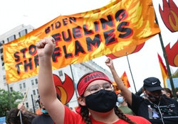 WASHINGTON, DC - OCTOBER 12: Climate protesters march to the White House on October 12, 2021 in Wash...