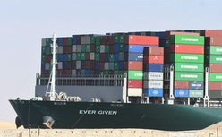 The Panama-flagged MV 'Ever Given' container ship is tugged in Egypt's Suez Canal after it was fully...