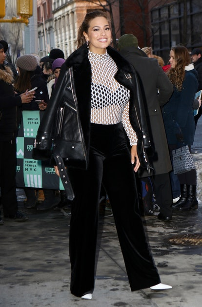 Ashley Graham wearing a black leather jacket in New York City.