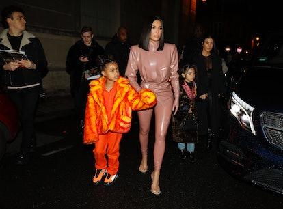 Kourtney Kardashian, daughter Penelope Disick, Kim Kardashian and daughter North West arrive at the ...