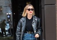 Hailey Bieber wearing a black leather jacket.
