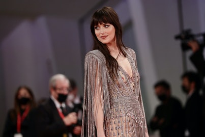 """VENICE, ITALY - SEPTEMBER 03: Dakota Johnson attends the red carpet of the movie """"The Lost Daughter""""..."""