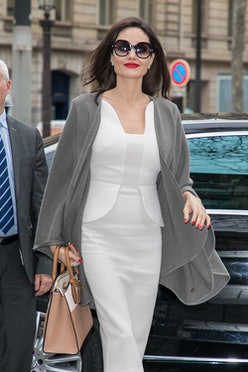 Angelina Jolie wearing a handbag.