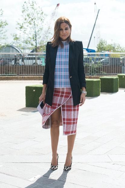 LONDON, ENGLAND - SEPTEMBER 16: Fashion editor for Harpers Bazaar Australia Christina Centenera wear...