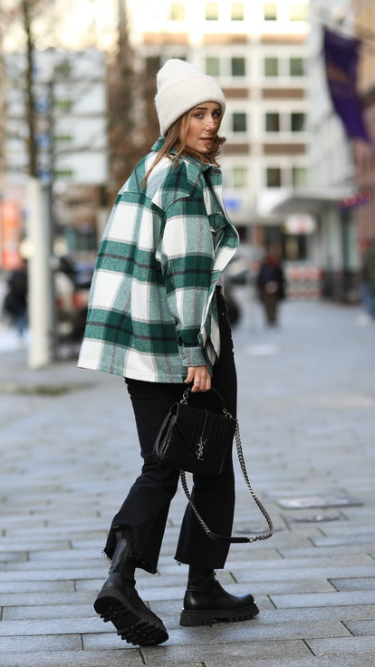 HAMBURG, GERMANY - DECEMBER 15: Maike Schmitz wearing Zara shoes and flannel, Closed shirt, Levi's R...