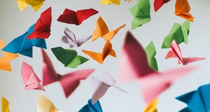 Falling coloured origami paper butterflies. Conceptual.