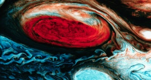 The Great Red Spot in false color. At lower right is one of the White Ovals which chase the red spot...