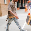 NEW YORK, NY - JULY 08:  Travis Scott is seen in walking out of a hotel in SoHo on July 8, 2021 in N...