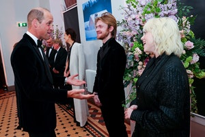 Britain's Prince William, Duke of Cambridge (L) talks to US singer-songwriter Finneas O'Connell (C) ...
