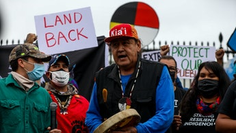 WASHINGTON, US - OCTOBER 11: Hundreds of Native Americans and supporters of environment advocacy org...