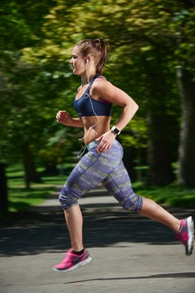 A woman runs while her Apple Watch tracks her workout and heart rate. All the health trackers on you...