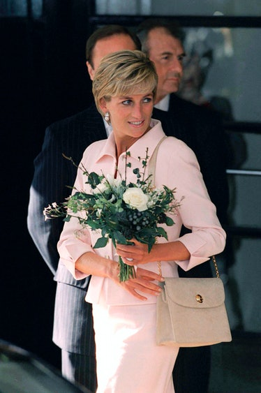 Princess Diana wears a shoulder bag from Versace.