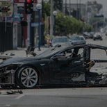 The Tesla's front half. A stolen Tesla automobile wrecked on La Brea Ave in LA after a police chase....