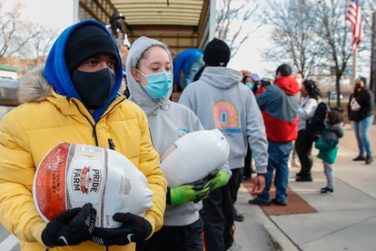 Volunteers distribute free turkeys to those in need on behalf of Chance The Rapper charitable founda...