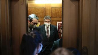 WASHINGTON, DC - OCTOBER 06: Sen. Joe Manchin (D-WV) speaks to reporters as he departs from the Sena...
