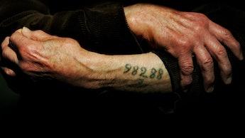 LONDON - DECEMBER 9:  Auschwitz survivor Mr. Leon Greenman, prison number 98288, displays his number...
