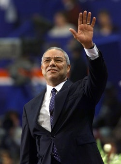 Former General Colin Powell waves to the crowd during his speech to the evening session of the 2000 ...
