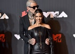 Travis Barker and Kourtney Kardashian at the VMAs. Months later, the two got engaged, and Kourtney K...