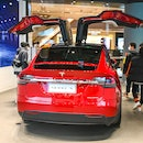 SHANGHAI, CHINA - JANUARY 04: Customers watch a Model X vehicle at a Tesla flagship store on January...