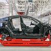09 October 2021, Brandenburg, Grünheide: A Tesla Model Y is seen in a production hall of the Tesla G...