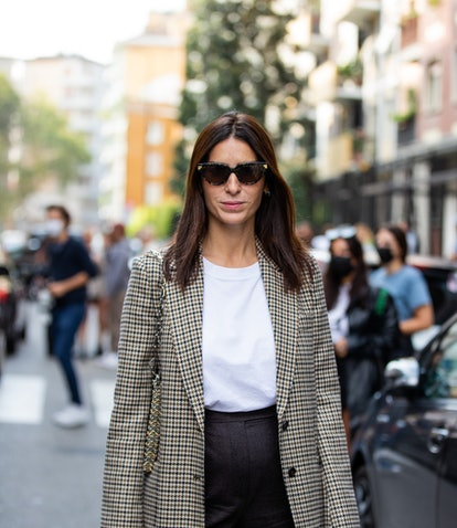 MILAN, ITALY - SEPTEMBER 23: Deborah Reyner Sebag wearing checkered blazer is seen outside Max Mara ...