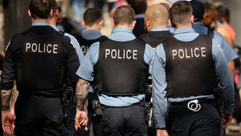 CHICAGO, ILLINOIS - OCTOBER 19: Chicago police officers patrol downtown as the city celebrates the C...
