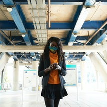 Woman wearing a face mask in the UK
