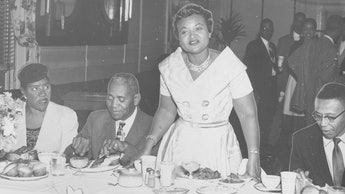 Mamie Bradley, mother of lynched teenager Emmett Till, stands with her father John Carson (left) and...