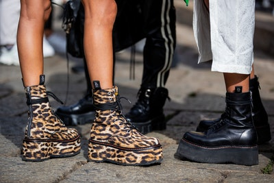MILAN, ITALY - SEPTEMBER 26: A guest is seen wearing boots with animal print, black boots outside Dr...