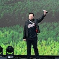09 October 2021, Brandenburg, Grünheide: Elon Musk, Tesla CEO, stands on a stage at the Tesla Gigafa...
