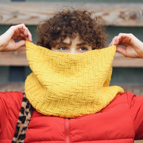 A person holds a yellow scarf over their face. Scorpio season 2021 will have you experiencing intens...