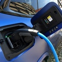 An electric car is charged at the stand of German car maker BMW at the Max-Joseph-Platz square in Mu...