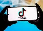POLAND - 2021/09/23: In this photo illustration a TikTok logo seen displayed on a smartphone. (Photo...