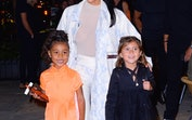 Kim Kardashian with North West and Penelope Disick, who have had adorable Halloween costumes in the ...