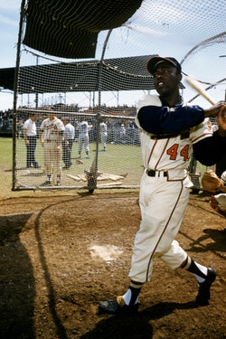 BRADENTON, FL - MARCH, 1958: Hank Aaron #44 of the Milwaukee Braves swings at the pitch during an ML...