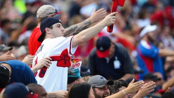 """ATLANTA, GA - AUGUST 20:  Atlanta Braves fans doing the """"Tomahawk Chop"""" during the game against the ..."""