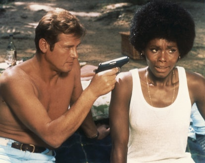 """Actor Roger Moore and actress Gloria Hendry on the set of """"Live And Let Die"""". (Photo by Sunset Boule..."""