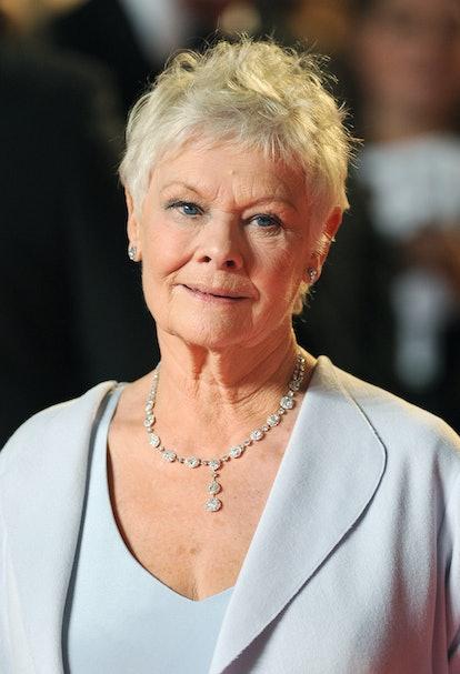 Dame Judi Dench arrives at the Royal World premiere of Skyfall at the Royal Albert Hall, London.   (...