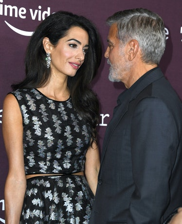 LOS ANGELES, CALIFORNIA - OCTOBER 03: George Clooney, Amal Clooney arrives at DGA Theater Complex on...