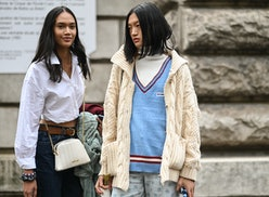 PARIS, FRANCE - OCTOBER 01: Model Tia Wan and Yilan Hua are seen outside the Loewe show during Paris...