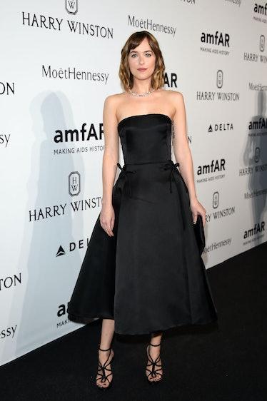 MILAN, ITALY - SEPTEMBER 26:  Dakota Johnson arrives at amfAR Milano 2015 at La Permanente on Septem...