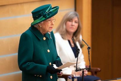 EDINBURGH, SCOTLAND - OCTOBER 02: Britain's Queen Elizabeth II delivers a speech in the debating cha...