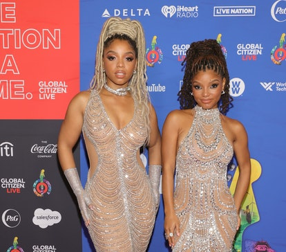 Chloe Bailey and Halle Bailey are twins in matching outfits.