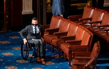 Rep. Madison Cawthorn, R-NC, arrives on the House floor in the Capitol in Washington, DC, before bei...