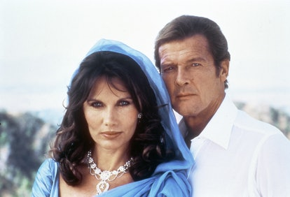 """Actor Roger Moore and actress Maud Adams on the set of """"Octopussy"""". (Photo by Sunset Boulevard/Corbi..."""