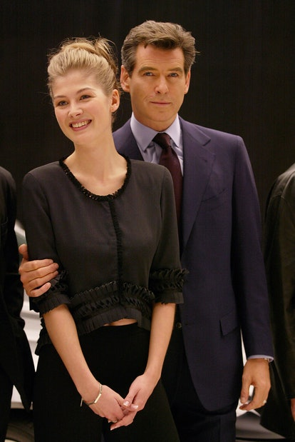 """Rosamund Pike and Pierce Brosnan Pinewood Studios. England The launch of """"BOND 20"""" photo by Dave Hog..."""
