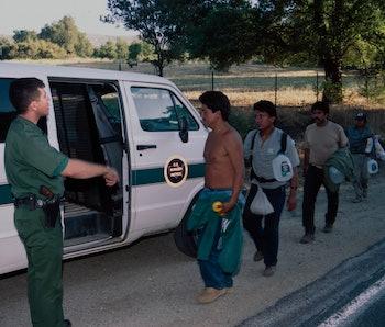 CAMPO, CALIFORNIA - JULY 20 : U.S. Border Patrol agent monitors a group of undocumented migrants arr...