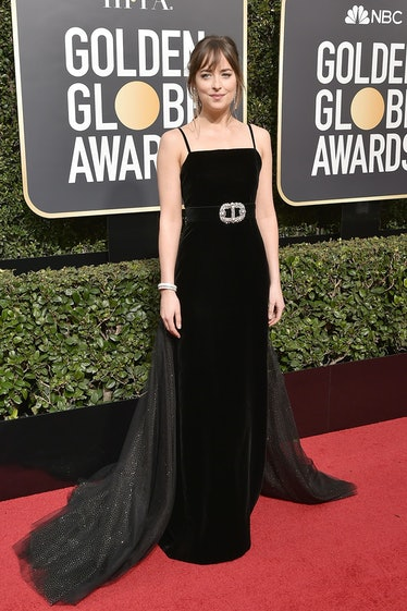 BEVERLY HILLS, CA - JANUARY 07:  Dakota Johnson attends the 75th Annual Golden Globe Awards - Arriva...